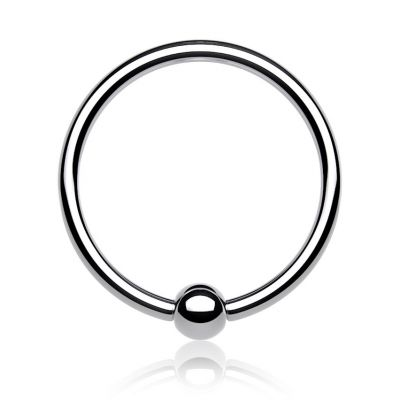 Ring in titanium with fixed ball